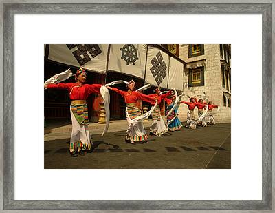 Tibetan Dancers Perform At The Chinese Framed Print by Richard Nowitz