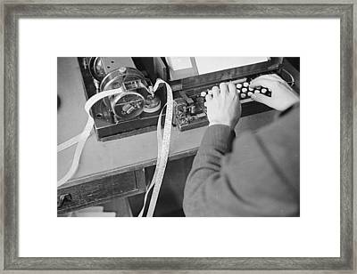 Ticker Tape Typing Framed Print by Fox Photos