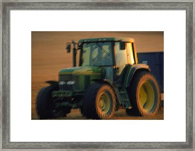 Time-exposure Image Of A Tractor At Work Framed Print