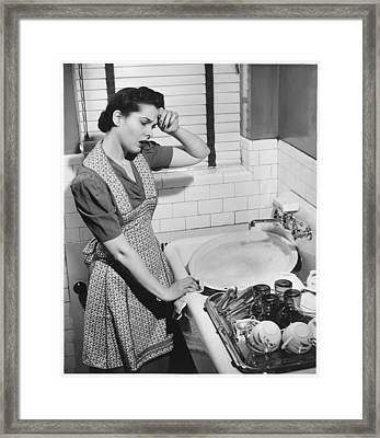 Tired Woman At Kitchen Sink, (b&w), Elevated View Framed Print by George Marks