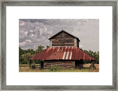 Tobacco Barn On Stormy Day Framed Print