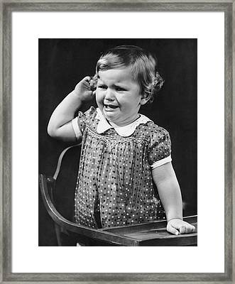Toddler Crying In Her Highchair Framed Print by George Marks
