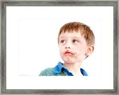 Toddler Eating Chocolate Framed Print by Tom Gowanlock