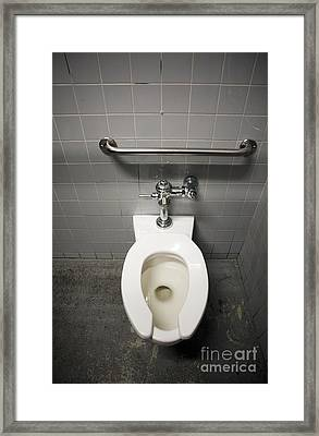 Toilet Bowl In A Tiled Restroom Framed Print