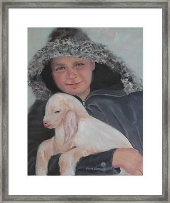 Tony With A Baby Goat Framed Print by Carol Berning