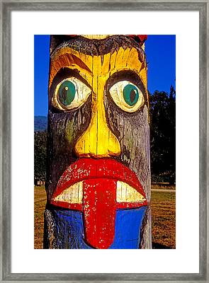 Totem Pole With Tongue Sticking Out Framed Print by Garry Gay