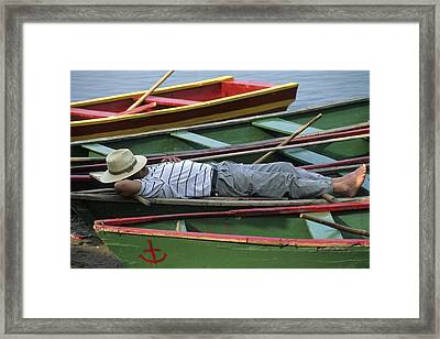 Tour Boat Guide Naps Amidst Rowboats Framed Print by Raymond Gehman