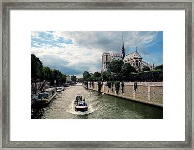 Framed Print featuring the photograph Tour Boat Passing Notre Dame by Dave Mills