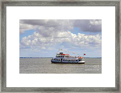 Touring Boat Framed Print by Carlos Caetano