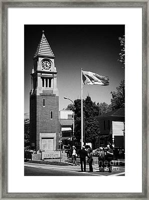 Tourists At The Cenotaph Clock Tower Niagara-on-the-lake Ontario Canada Framed Print by Joe Fox