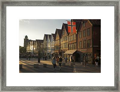 Tourists Walking In A Street In Bergen Framed Print by Michael Melford