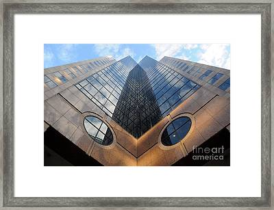 Towering Modern Skyscraper In Downtown Framed Print