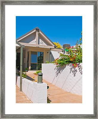 Townhouse In The Sun Framed Print by Paul Donohoe