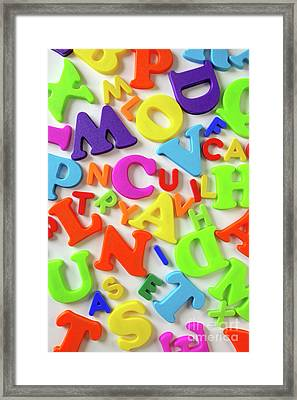 Toy Letters Framed Print by Carlos Caetano