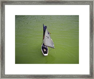 Toy Sailboat On Pond Framed Print by Donna Munro