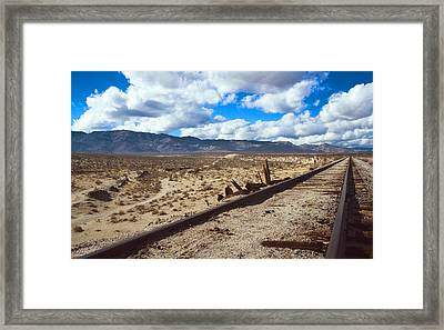 Track To The Mountains Framed Print by Jeffery Reynolds