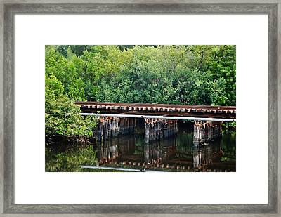 Tracks On The River Framed Print by Rob Hans