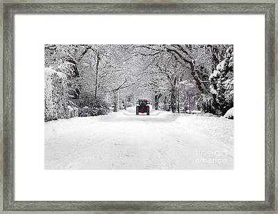 Tractor Driving Down A Snow Covered Road Framed Print by Richard Thomas