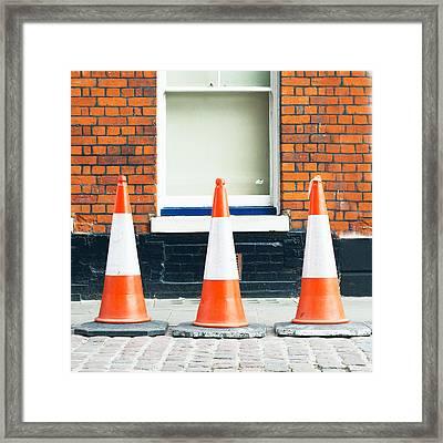 Traffic Cones Framed Print by Tom Gowanlock