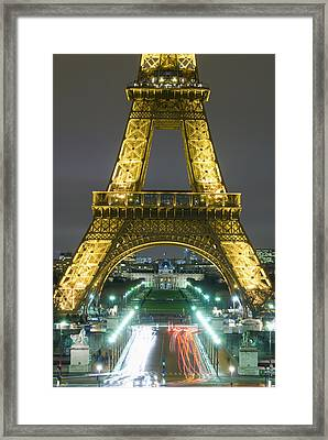 Traffic On Champs Delysees Under Eiffel Framed Print by Axiom Photographic
