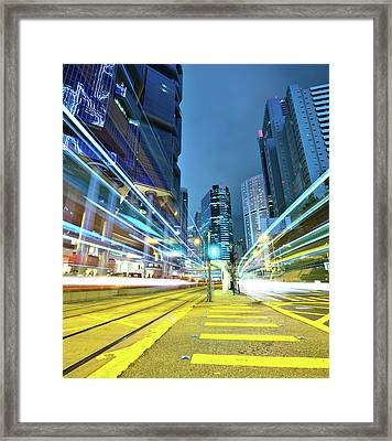 Traffic Trails In City Framed Print by Leung Cho Pan