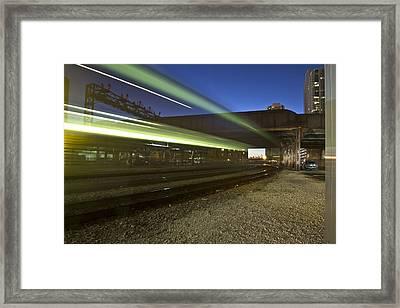 Train Creates Green Streaks Of Light Framed Print by Sven Brogren