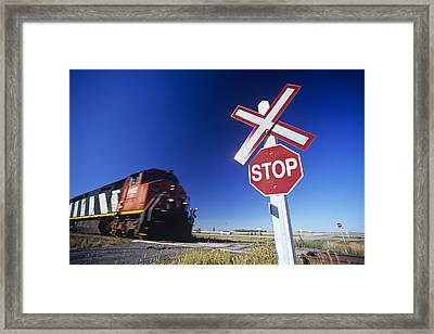 Train Passing Railway Crossing Framed Print by Dave Reede