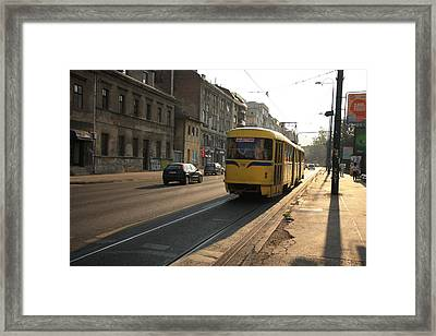 Tramway In The Morning Light Framed Print by Frederic Vigne
