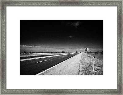 Trans Canada Highway 1 And Yellowhead Route In Manitoba Canada Framed Print by Joe Fox