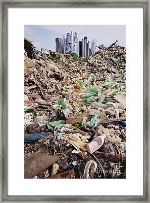 Trash Mound With Modern Office Buildings Behind Framed Print