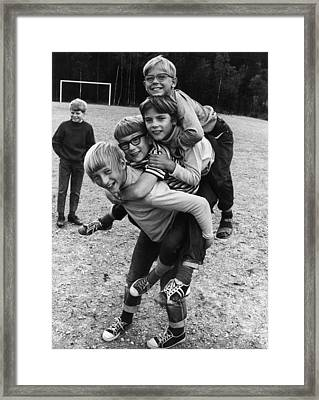 Triple Piggyback Ride Framed Print by Archive Photos