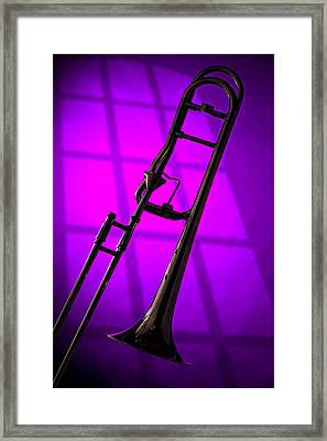 Trombone Silhouette On Purple Framed Print by M K  Miller