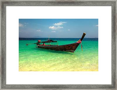 Tropical Boat Framed Print by Adrian Evans