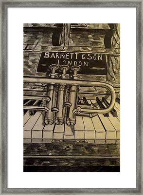 Trumpet On Piano Framed Print