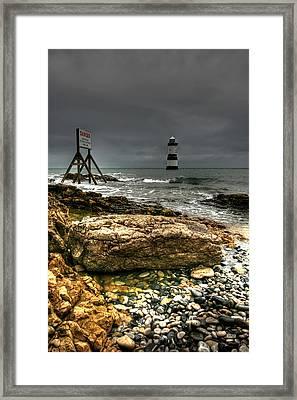 Trwyn Du Lighthouse Framed Print by Adrian Evans