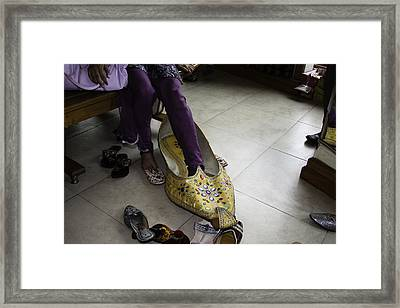 Framed Print featuring the photograph Trying On A Very Large Decorated Shoe by Ashish Agarwal