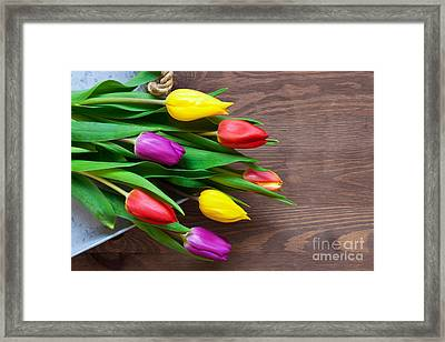 Tulips On The Table Framed Print by Richard Thomas
