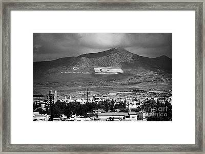 Turkish Symbols And Turkish Cypriot Flags In Besparnak Mountain Overlooking Nicosia Cyprus Framed Print by Joe Fox