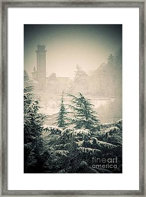 Turret In Snow Framed Print by Silvia Ganora