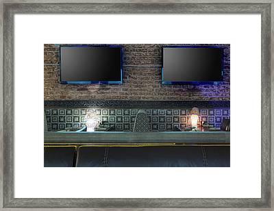 Tvs On Brick Wall In Restaurant Framed Print by Magomed Magomedagaev