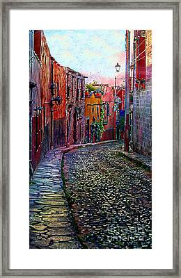 Twilight In San Miguel De Allende Framed Print by John  Kolenberg