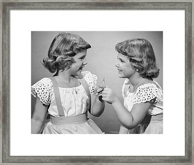 Twin Sisters Making A Wish Framed Print by George Marks