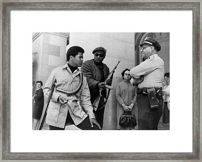 Two Armed Black Panthers, Carrying Framed Print by Everett