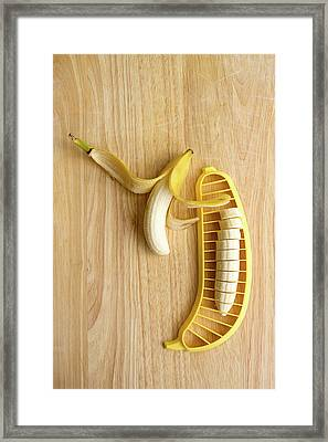 Two Bananas On Cutting Board Framed Print