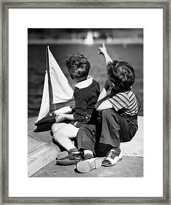 Two Boys Playing W/sailboats Framed Print by George Marks