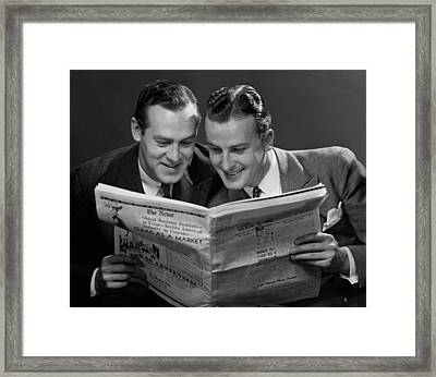 Two Businessmen Reading Newspaper Framed Print by George Marks