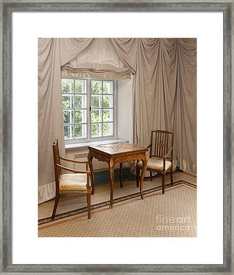 Two Chairs And A Small Table Framed Print