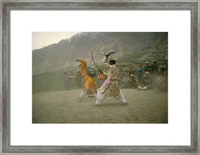 Two Dancers Perform A Local Dance Using Framed Print