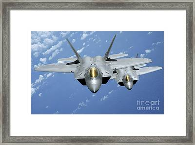 Two F-22 Raptors Fly Over The Pacific Framed Print