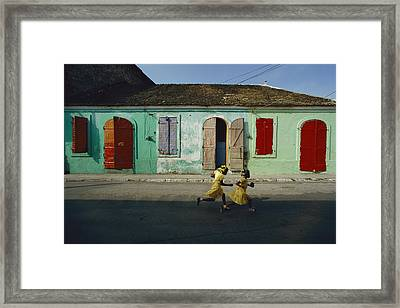Two Girls Run From The Photographer Framed Print